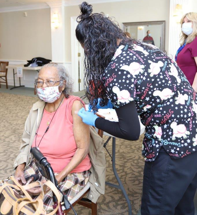 99-year-old Golden M. Strayhorn receives her JJ vaccination at the Somerville Senior Citizen's Housing complex. Ms. Strayhorn said she was glad to be vaccinated so she could have more visits with her three grandsons.